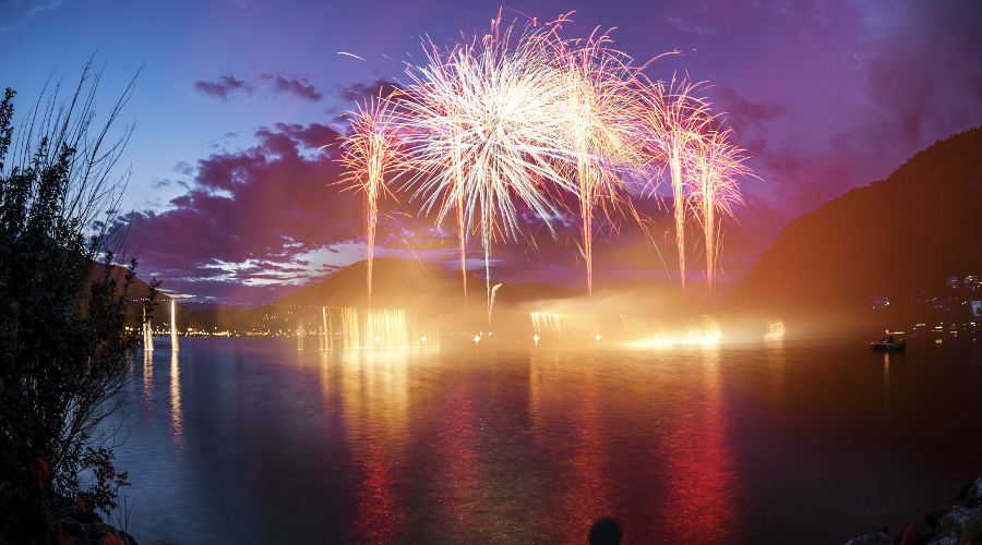 Fireworks on the Lugano Lake in a summer evening